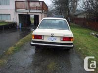 Classic bmw. it's a E30 318i automatic with a very