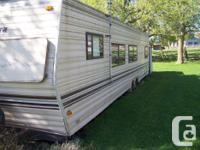 34 foot travel trailer (looks like a prowler) 2