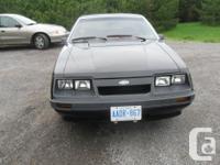 Make Ford Model Mustang Colour Black Trans Manual kms
