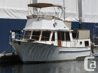 An unusual 35' CHB Tri-Cabin Heritage Course Trawler. 2