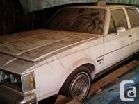 OLDS CUTLASS SUPREME, barn saved for several years, was