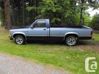 Make. Dodge. Year. 1988. Colour. Blue. Trans.