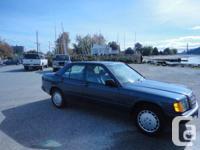 Mercedes 190E, blue 4-door sedan for sale. Good running