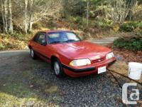 Make. Ford. Version. Mustang. Year. 1988. Colour. red.