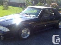 5.0 lit, 5 spd, black exterior, grey leather interior,