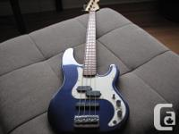 Here is a rare and beautifully appointed bass. It has