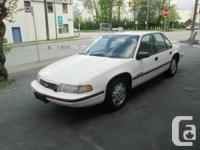 1990 Chevrolet Lumina  White / Red 1990 Chevrolet