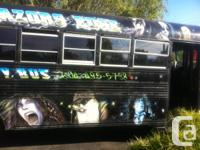 1990 GMC blue bird bus painted with rock stars all