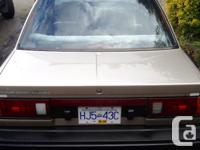 Make Nissan Model Sentra Year 1990 Colour champagne