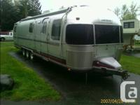 1991 Airstream 34 foot triple axle.  Twin beds in rear.