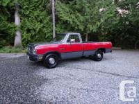 Make Dodge Model D250 Year 1991 Colour Charcoal & Red