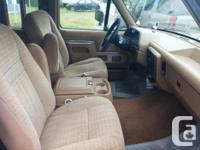 Make Ford Year 1991 Colour Brown Trans Automatic kms