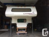 "8'6"" truck camper. Approx. 2,000 lbs,, 3 way fridge,"
