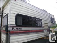 1992 Elkhorn 8.5 foot camper. Four burner stove,