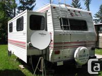 26.5 ft Jayco 5th wheel set up in park on Kootenay