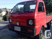 I have a 1993 Mitsubishi MiniCab Truck.  4x4 4 speed