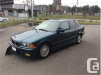 Make BMW Model 320i Year 1994 Colour Blue kms 163021