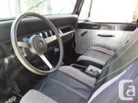 Make Jeep Model Wrangler Year 1994 Colour mostly black