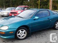 Make Mazda Year 1994 Colour Green Trans Manual kms