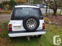 Make Suzuki Model Sidekick Year 1994 Colour white