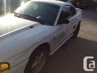 Make Ford Colour White Trans Automatic 1995 Ford