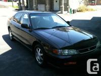 It's an Automatic, 2.7L 4 doors black Honda Accord The