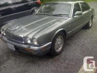 UP FOR SALE IS A SOLID, NO RUST, NICE DRIVING JAGUAR!