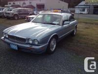 Make. Jaguar. Design. XJR. Year. 1995. Colour. Blue.
