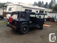 Four cylinder. 232,000km. Brand new soft top, hard top.