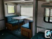 Sportsmen 2550 fifth wheel with slide and bunks. Newer