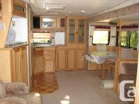Snowbird trailer in good condition. Very roomy /w large