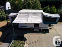 A 1996 Coleman Yukon tent trailer. It sleeps 7 with a