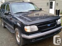 Make. Ford. Year. 1996. Colour. Black, With Tan Natural