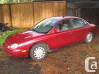 Make Ford Model Taurus X Year 1996 Colour red kms
