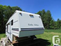 Beautiful 35 foot Golden Falcon 5th wheel with 2 push