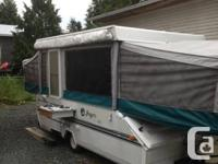 1996 jayco camping tent trailer has a king-size bed in