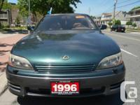 Green with 6 cylinder automatic transmission, air-con,