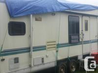 Functional, roadworthy and spacious 5th wheel for sale.