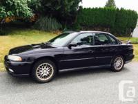 Make Subaru Model Legacy Year 1997 Colour Black kms