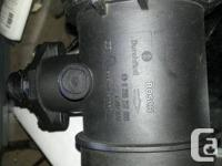 BOSCH MASS AIR FLOW SENSOR FOR 1997 BMW 740IL HAS ROUND