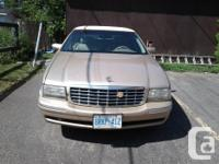 Make Cadillac Model DeVille Year 1997 Colour Tan kms