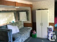 The trailer is winterized and has two bunks in the