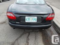 Make Jaguar Model XK Year 1997 Colour green kms 130221