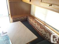 All fiberglass Kodiak camper in excellent condition.