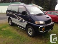 Make Mitsubishi Year 1997 Colour Blue Trans Automatic