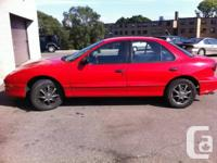 1997 red Sunfire SE 4 door sedan 116,872 original km,
