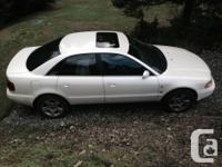 Make Audi Model A4 Year 1998 Colour Pearl White kms