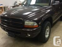 Make Dodge Year 1998 Colour Brown Trans Automatic kms