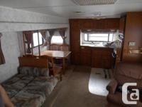 Luxurious tandem 31' Trip trailer with single 13'