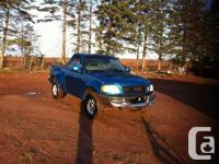Make. Ford. Model. F-150. Year. 1998. Colour. Teal.